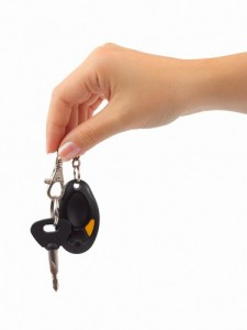 Hand and car key